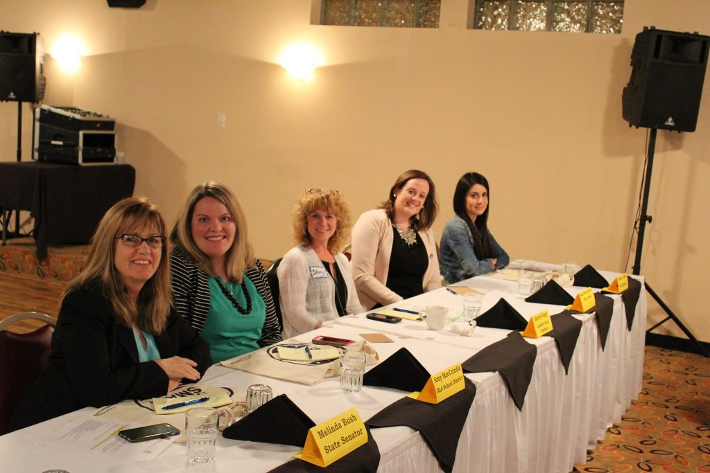 Sandra is pictured with other panelists at a Women's Empowering Business Event.